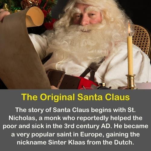 Old Santa Claus with a candle