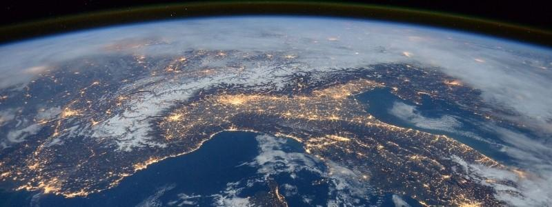 An image of the earth and its continents geography at night.