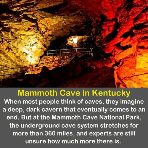 An image of Mammoth cave in Kentucky with red-yellow lights.