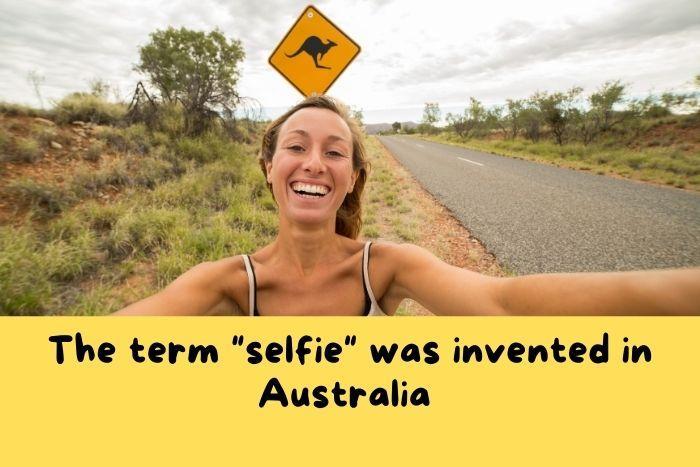 A woman take selfie with kangaroo sign in Australia.