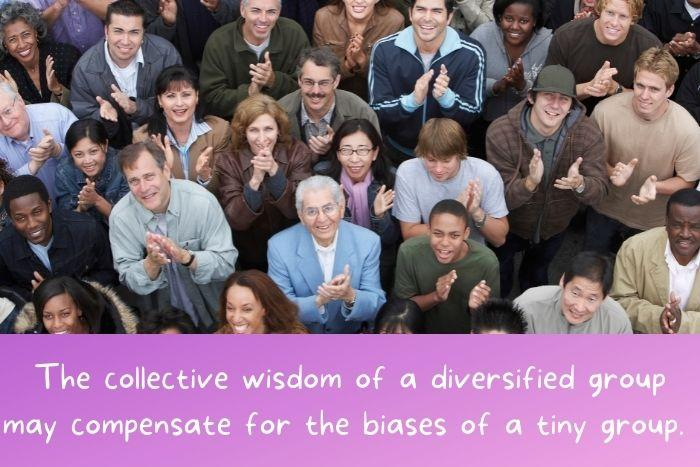 A diversified group of people looking up and clapping.