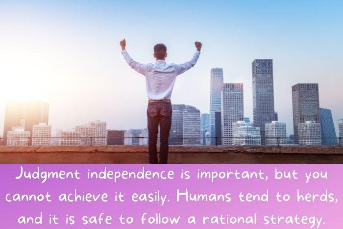 A man standing, raising his hands, and looking forward celebrating is independence.