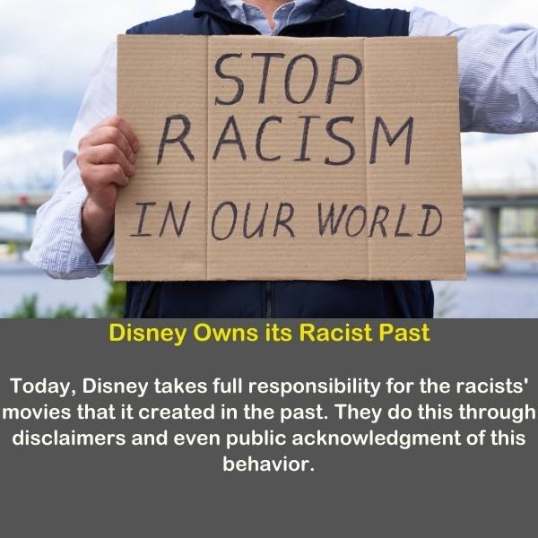 A person hold a sign to stop racisms in the world.