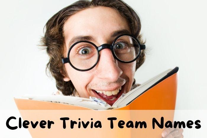 A funny clever young man playing trivia and smiling.