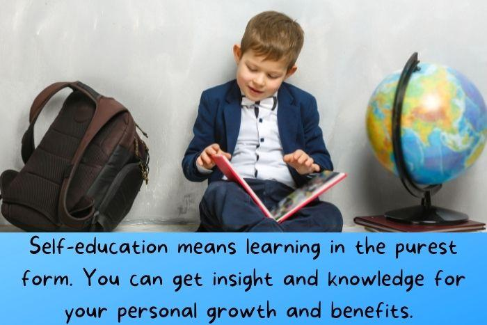 a kid is reading a book and educating himself.