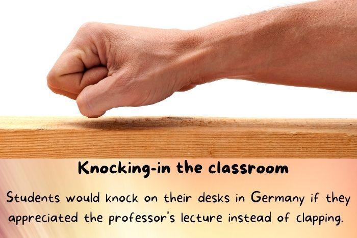 Knocking on a wooden desk.