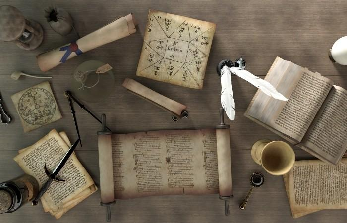 An old table with old papers illustrate how trivia was invented and it's origin.