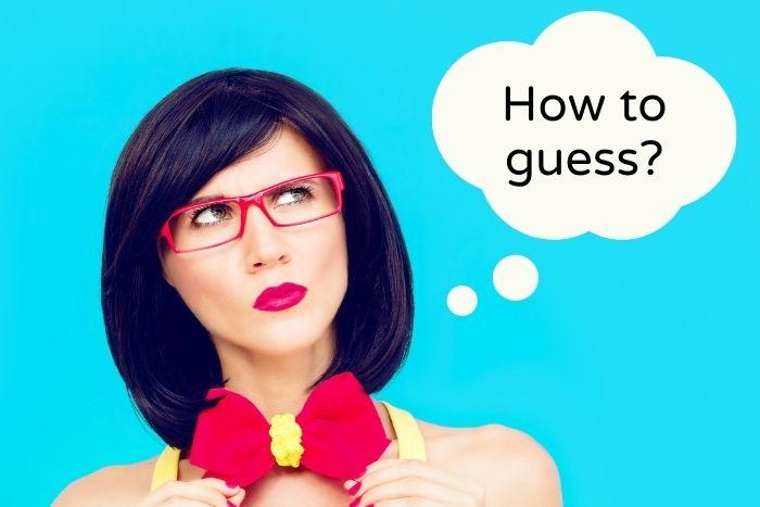 A funny woman thinking how to guess on a trivia night?