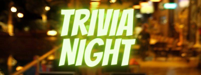 Trivia night is written in a big neon lights.