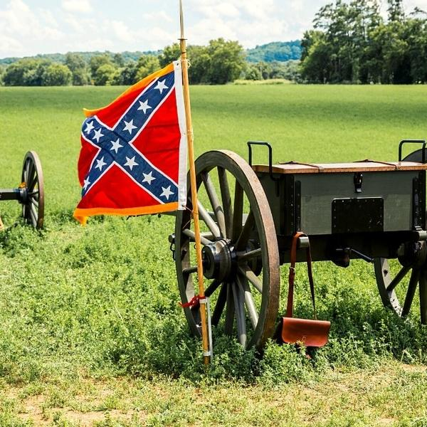 American civil war, confederate battle flag, cannon and limber.