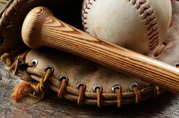 Baseball Glove, Baseball Bat, and a Baseball ball.