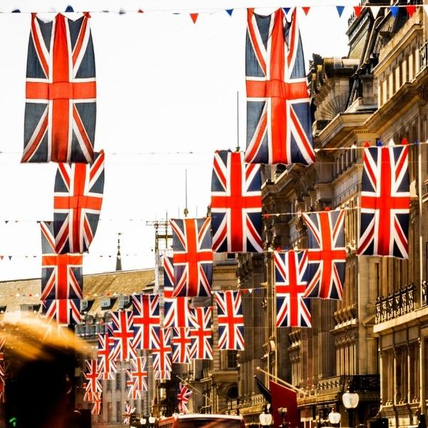 A British street with many British flags.