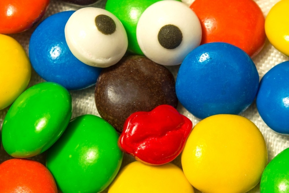 Funny faces made from M&M candy.