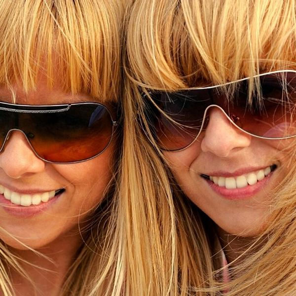 Two blonde twin sisters with matched sunglasses (Look Like Celebrities).
