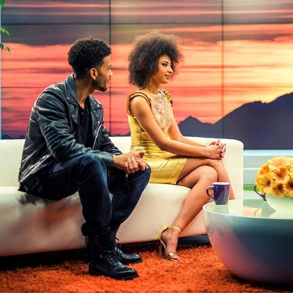 A Famous Couple of two celebrities is interviewing in a TV show.