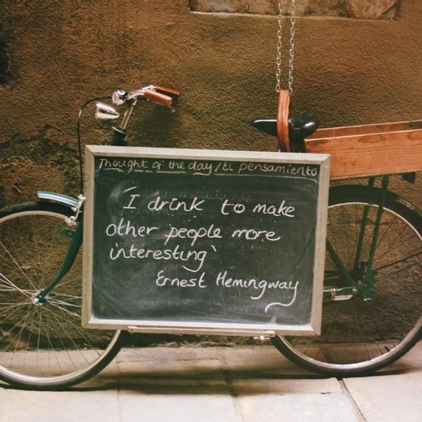 A film quotes written on a chalkboard on an old bike.