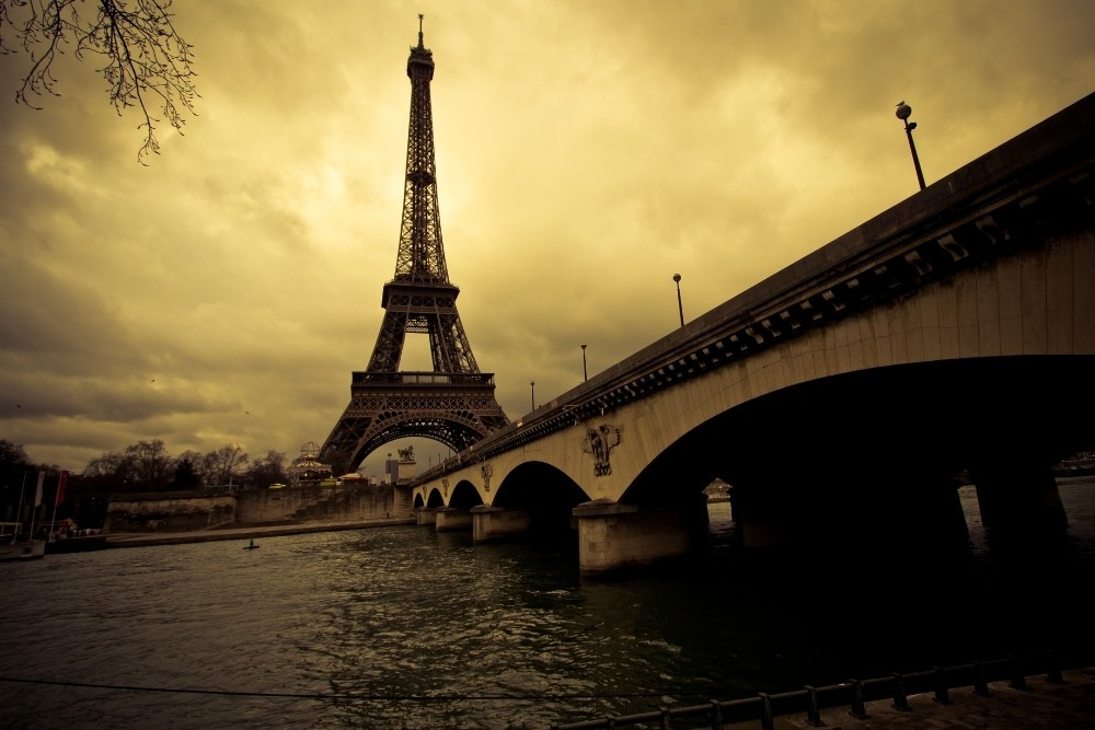 The Eiffel Tower, in Paris, France, During a dark day.