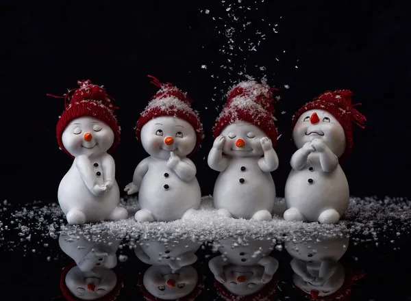 Four funny & cute snowmen.