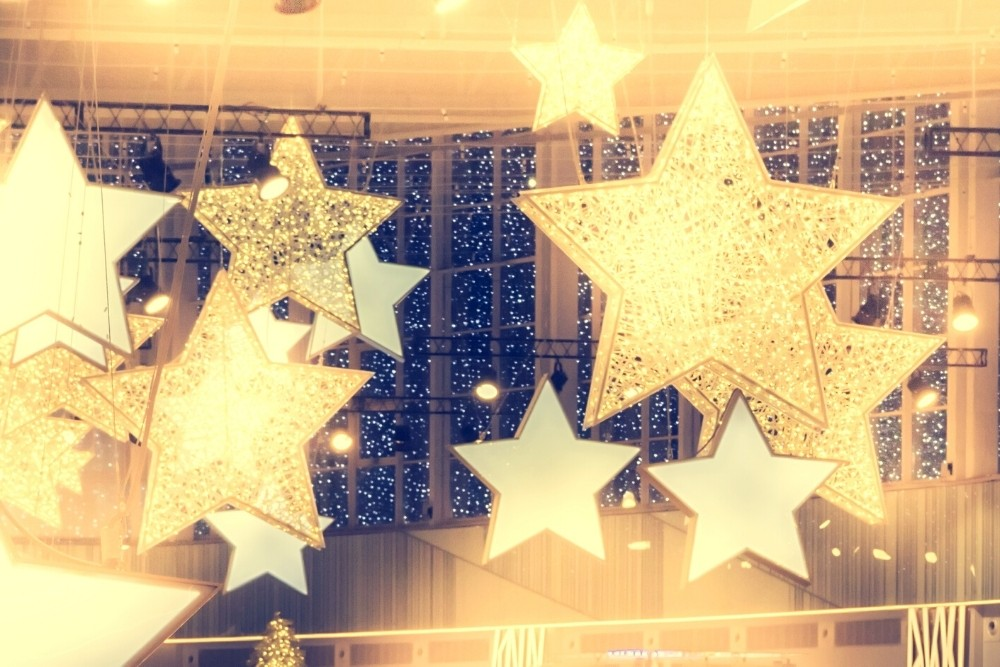 Golden stars symbolizing celebrities at a party.