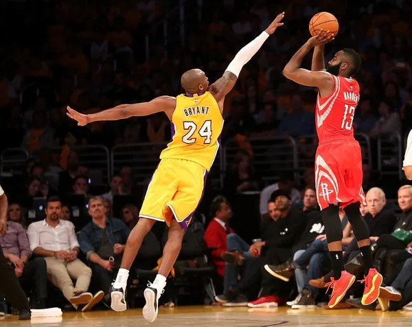 Kobe Bryant jumping to block James harden.