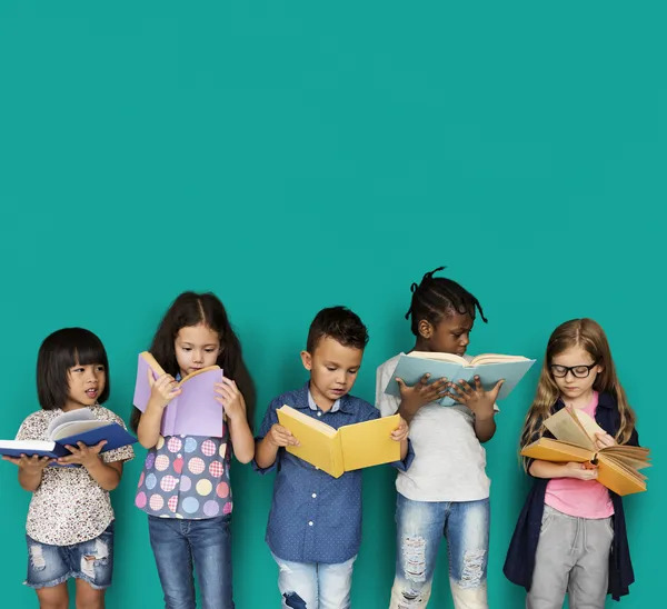 A group of kids study and reads books and fun facts.