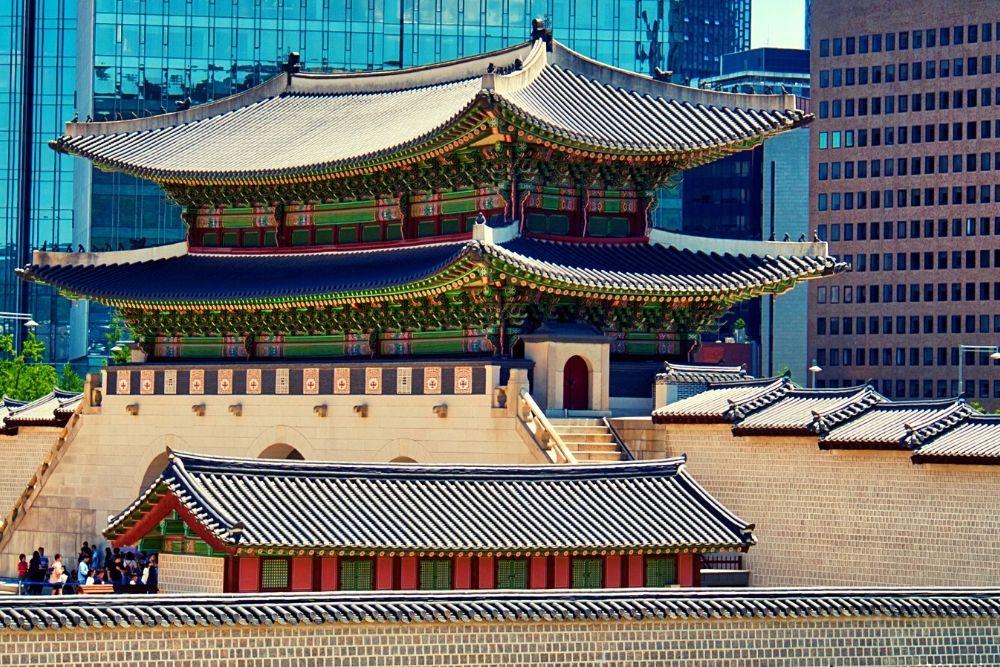 A traditional Korean building near modern buildings.