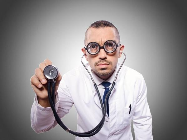 A doctor with a big eyeglass and medical stethoscope talking about Medical Terminology.