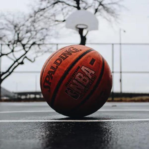 NBA basketball ball on a wet court in the winter.