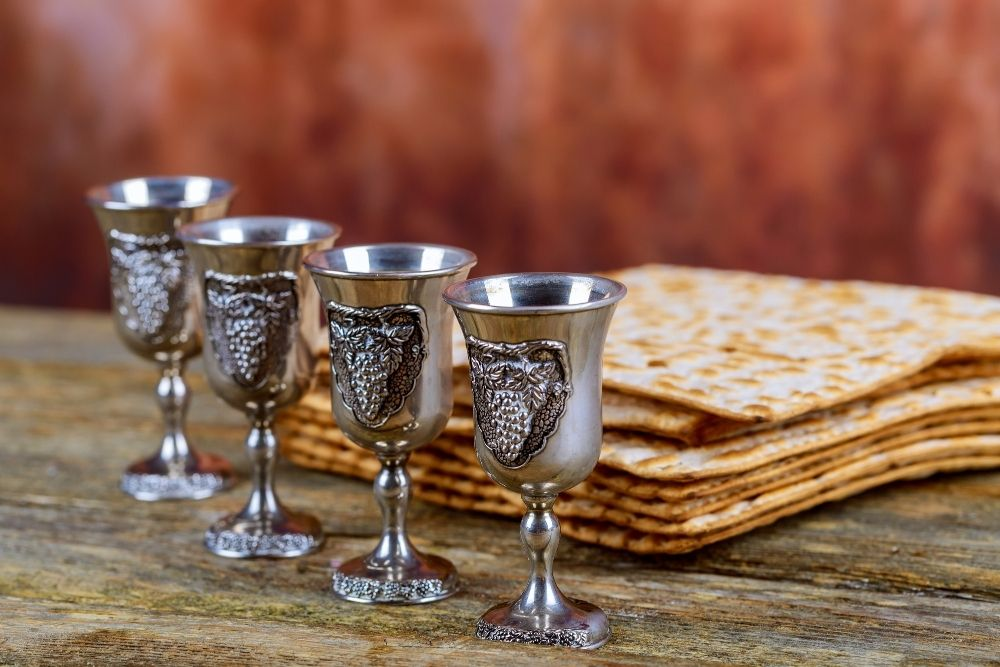 Matzah and a traditional glass of wine on Passover holiday night.