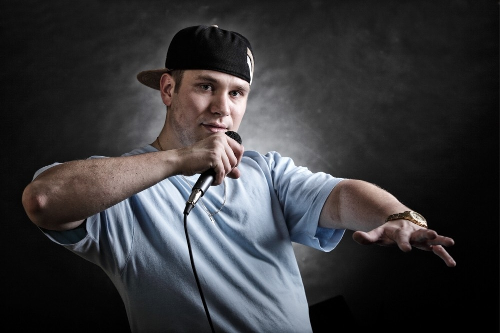 A cool rap singer dancing in a typical rap style.