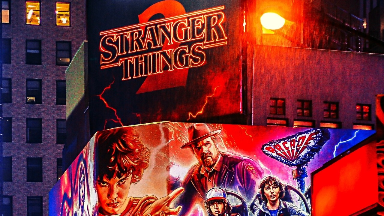 Stranger Things colorful logo with the series characters.