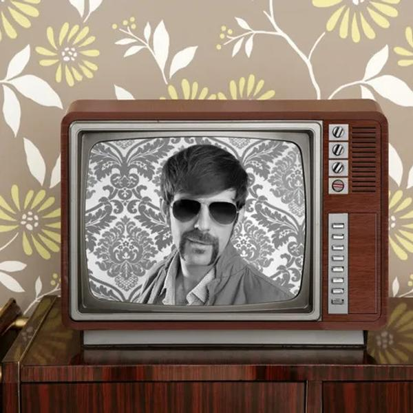 Retro vintage tv presenter hero on wood television.