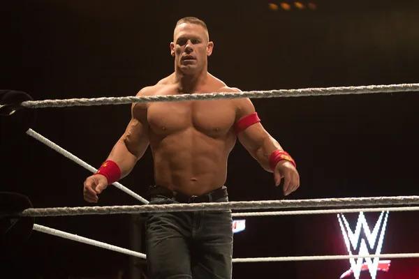 Garrett Coliseum from the WWE standing near the ropes.