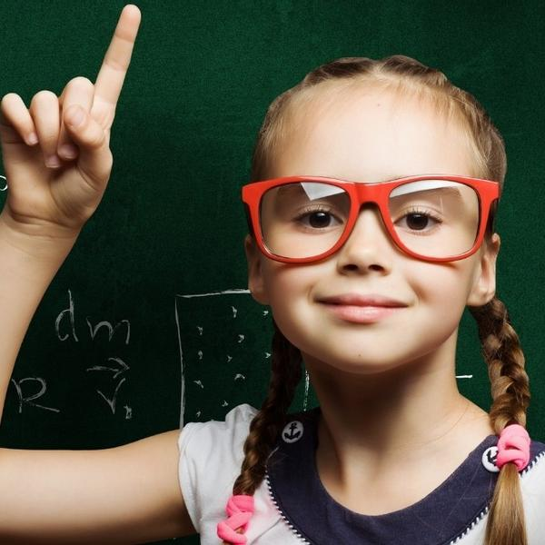 A funny girl with red glasses teaches Algebra.