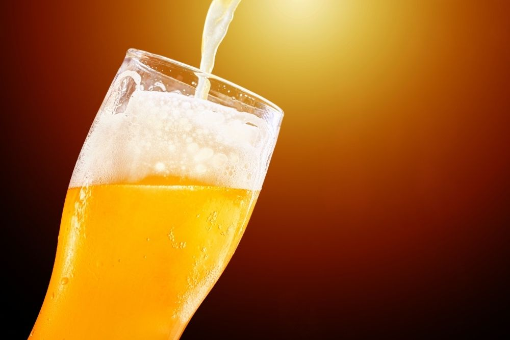 Beer is being poured into a special glass.