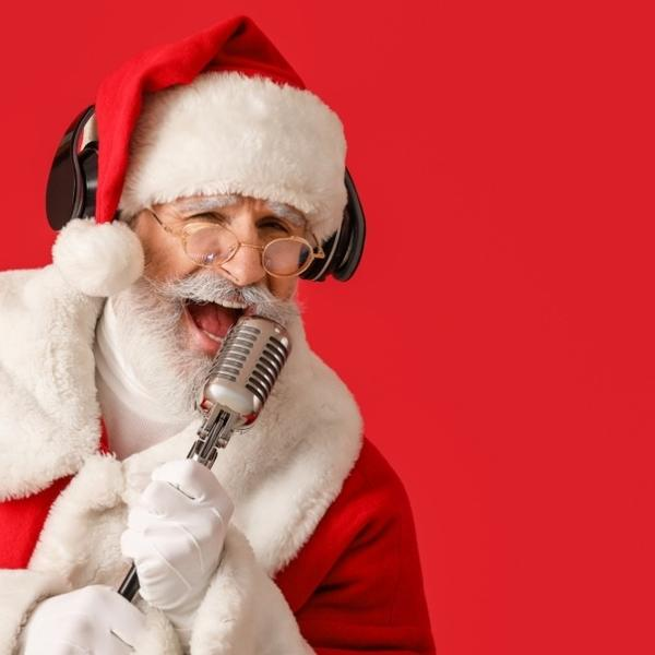 Funny Santa with glasses sings a Christmas song.