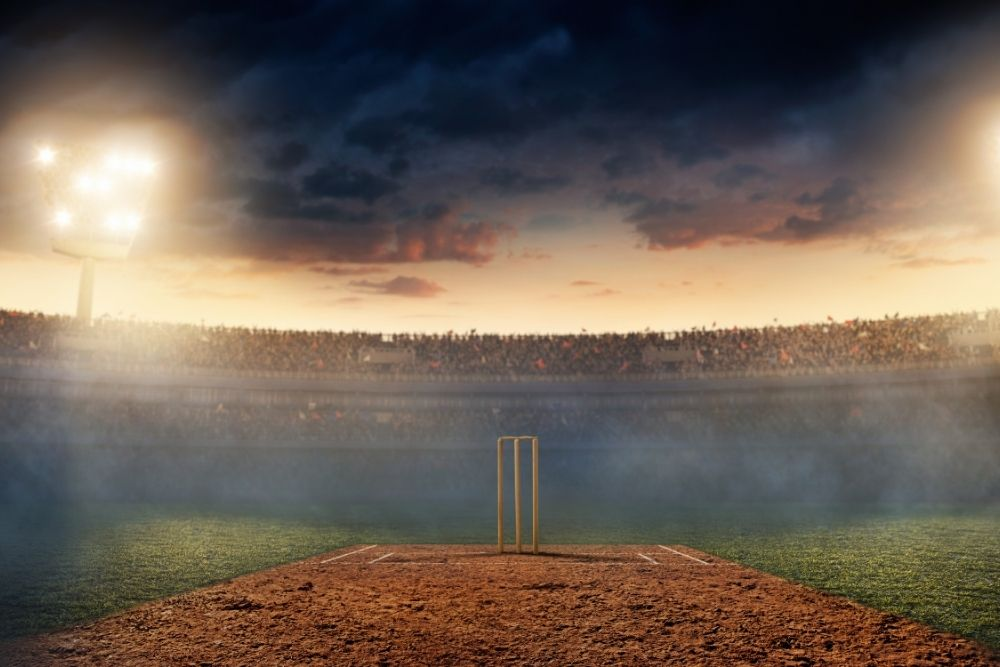 A Cricket stadium is full of a crowd of fans.