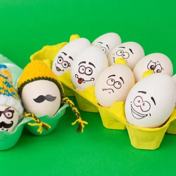 Cool hipster Easter eggs with funny knitted hats.