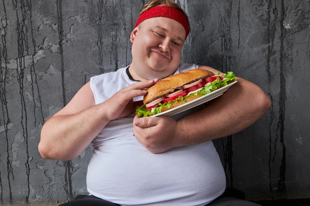 A funny man hugging his food.