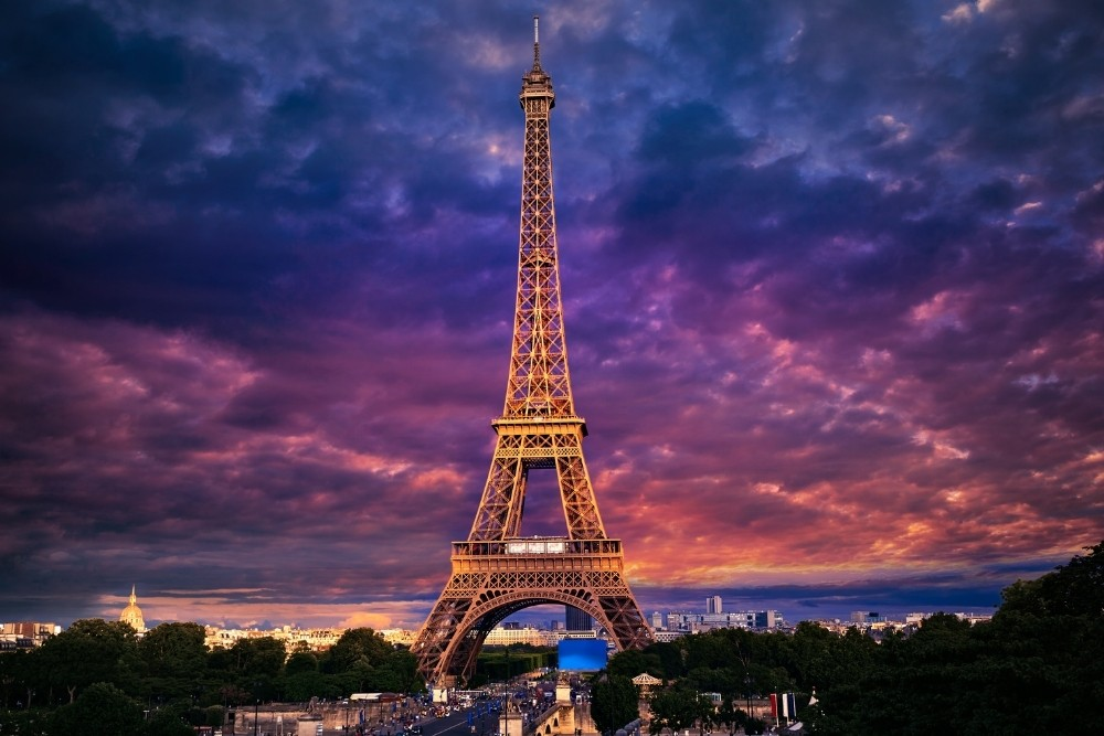 The Eiffel Tower, in Paris, at the Sunset time in France.