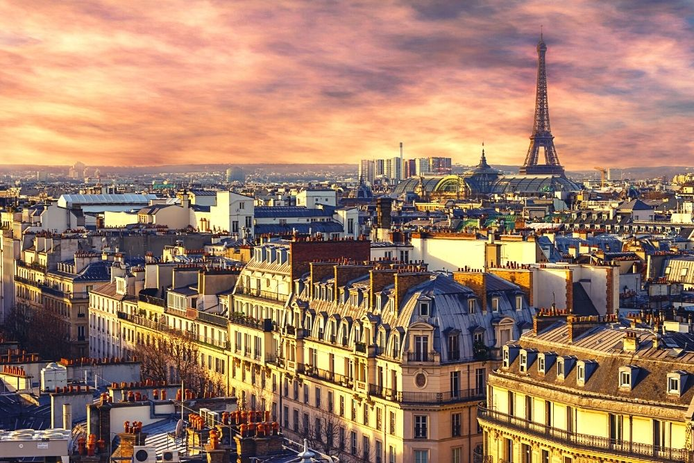 Paris and the Eiffel tower in France at twilight time.