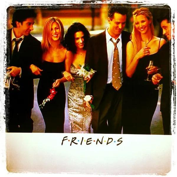 All 6 Friends actors walking and hugging together.