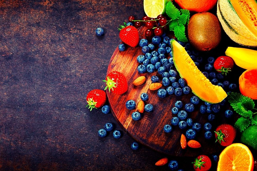 Colorful fruits on a black marble table.