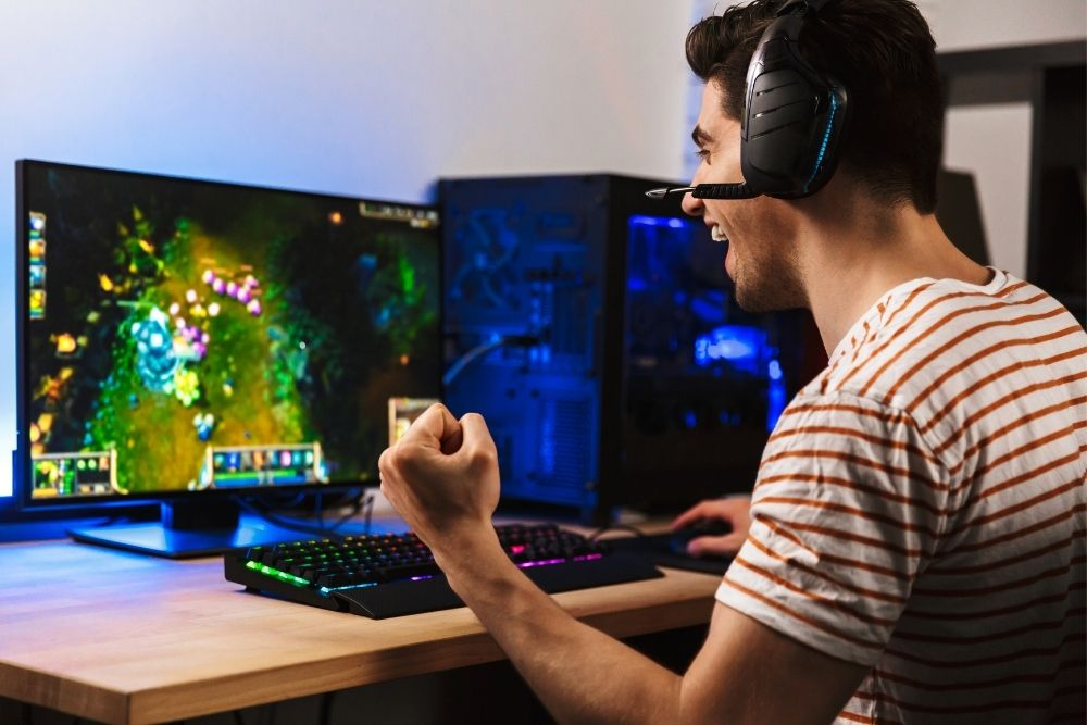 A man playing a video game on the PC.