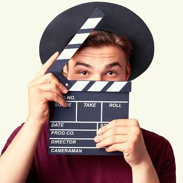 An actor hiding behind a movie clapper.