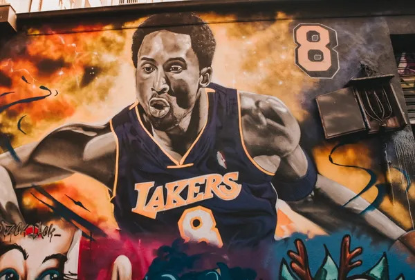 Street Painting of Kobe Bryant on an old wall.