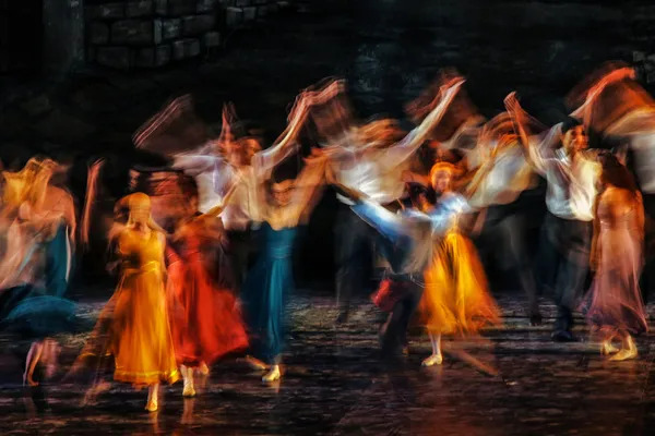 Dancers performing their high school musical - colorful photo in Long camera exposure