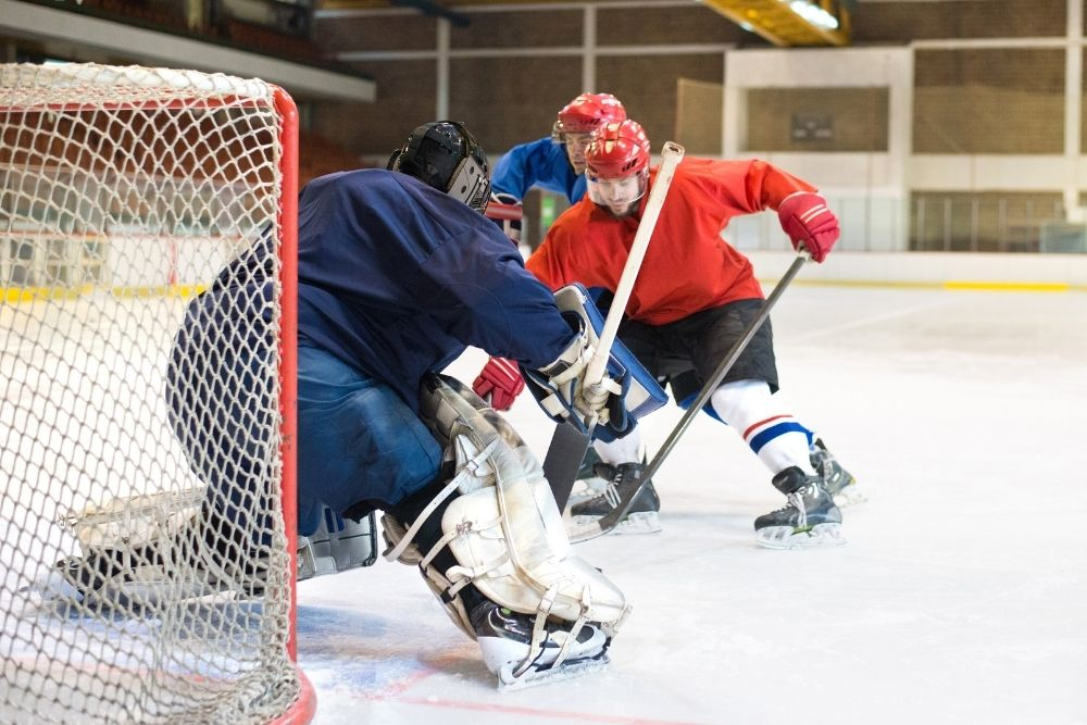 A Hockey (NHL) trying to score a goal.