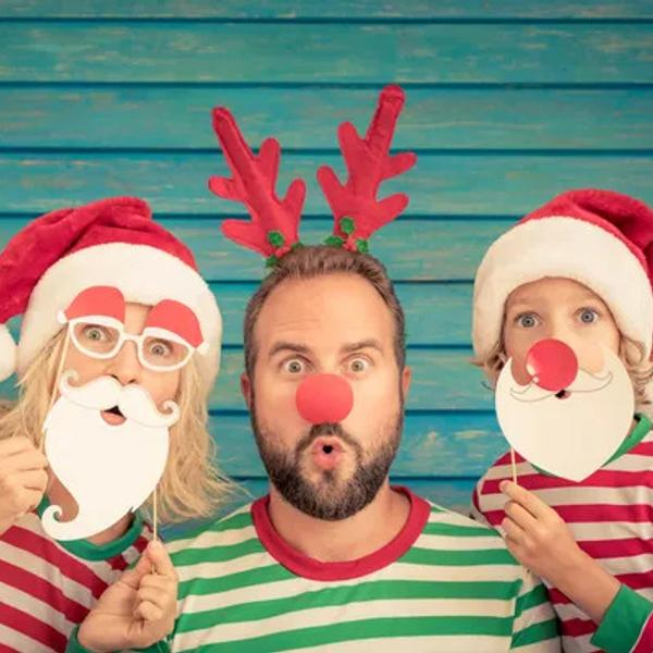 Christmas costumes - Funny father, mother and child on Christmas eve.
