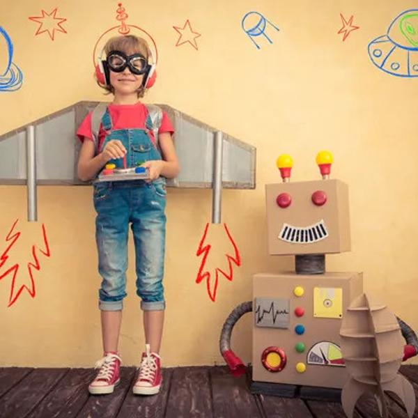 A Happy kid is playing with toy robots.